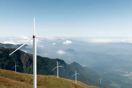 wind power farm over a hill
