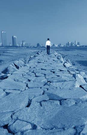 Man walking on river dams, modern urban fantasy landscape.