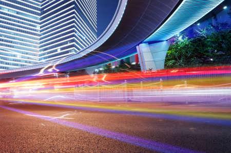 the light trails on the modern building background in shanghai china. Reklamní fotografie