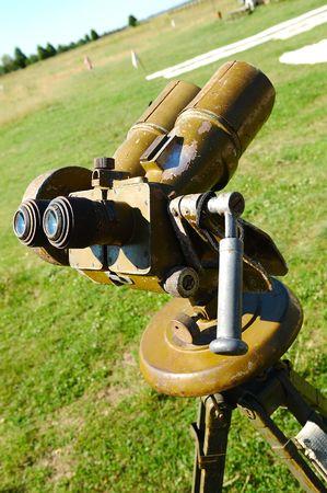 tripod mounted: old field binoculars mounted on tripod