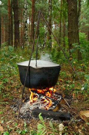Old pot on a campfire photo