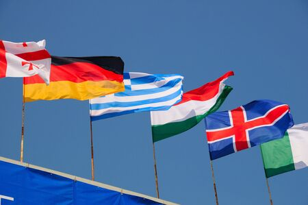 flapping: various national flags flapping in the wind Stock Photo