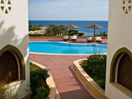 sunshades: Buildings and sunshades near resorts pool Stock Photo