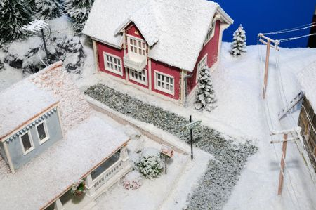 model of rural house covered by artificial snow Stock Photo - 3783954