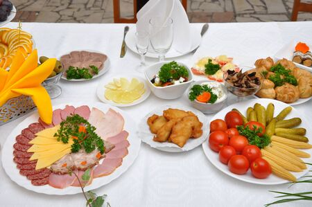 table served with various dishes photo