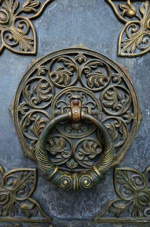 knocker: Bronze knocker on the church door