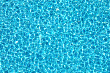 poolside: water surface of a resort swimming pool Stock Photo