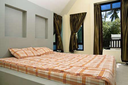 Sleeping room in a hotel photo