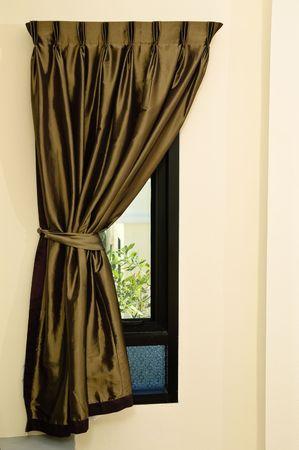 tassel: rippled textile curtain on a window Stock Photo