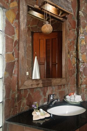 Thai style bathroom with stone walls photo