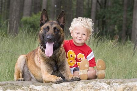 lovely blond boy with dog photo