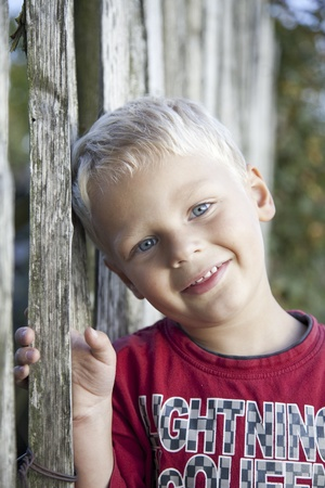 adorable young blond boy with red t-shirt photo