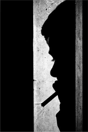 woman shadow: Shadow of woman smoking cigarette Stock Photo