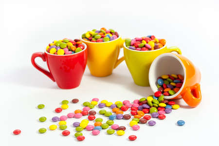dragees: Many colorful dragees in small colored cups Stock Photo