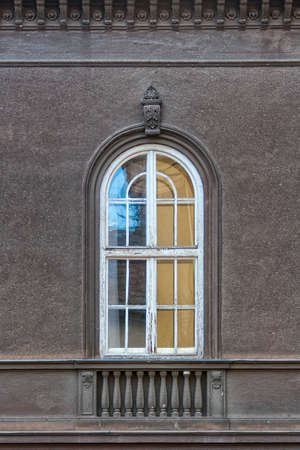 Old arched window, with weathered wooden frame Stockfoto