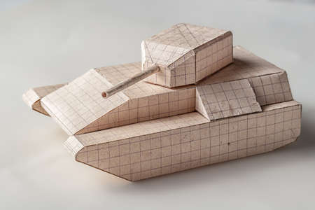 Tank model made of paper on white