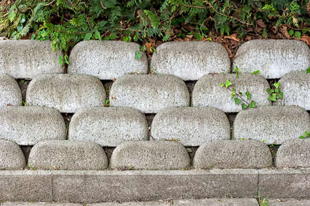 Form-work stone wall made of grey concrete bricks