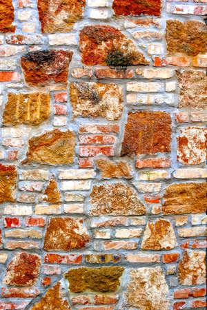 Rough grunge natural stone-brick wall pattern
