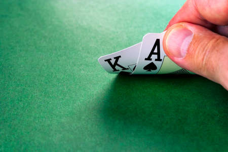 Cards on green surface, hand of black jack