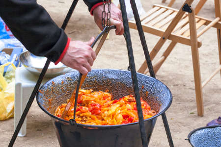 outdoor fireplace: Making hungarian ratatouille in a cauldron on a campfire