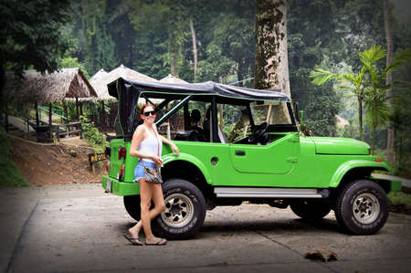 4x4: Woman Traveller with Green Jeep Car 4x4 in Thailand