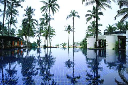 hotel resort: Beach Resort Hotel Pool with Palm Trees
