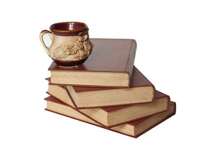 old books and a cup isolated on white Stock Photo - 10352292