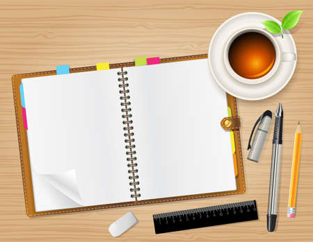 planner: open notebook and cup of tea