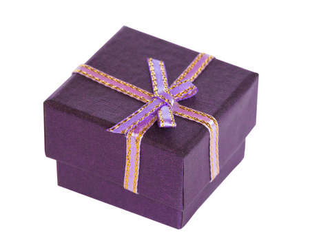 violet little gift box on white photo