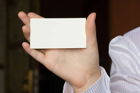 female hand holding a card photo