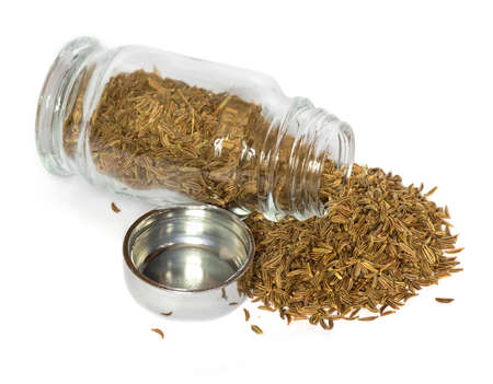 cumin: spices in glass bottle