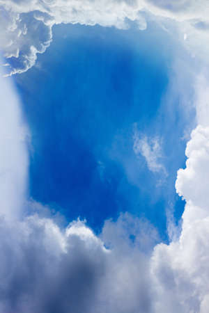 white clouds as frame in blue sky Stock Photo - 13504018