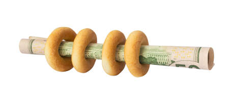 bagels with dollars on white photo