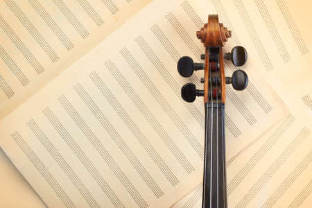 violin neck on old musical paper  photo