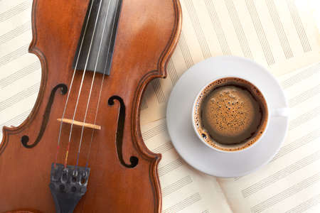 violin background: violin background and coffee cup top view