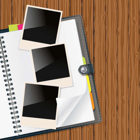 old diary: retro photo frames on open diary with wooden background