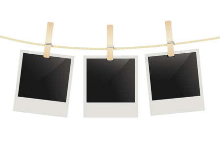 rope background: photo frames hanging on a rope with clothespins.