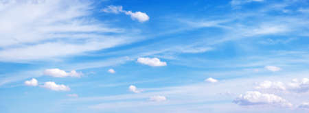 Amazing blue cloudy sky background. Panoramic composition. Stock Photo