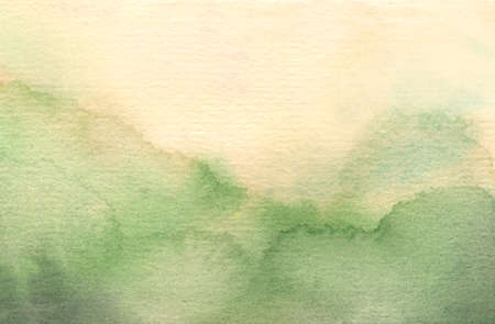 abstract watercolor background with pale green and yellow colors