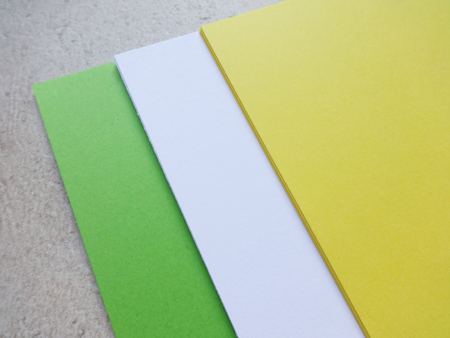 White, Green and Yellow Plain Paper Sheets