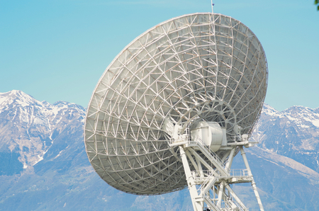 View of a huge satellite dish in the Alps. photo