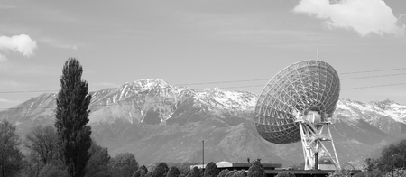 Large satellite dish in the Alps. photo