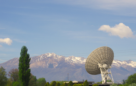 telephonic: View of a huge satellite dish in the Alps. Stock Photo