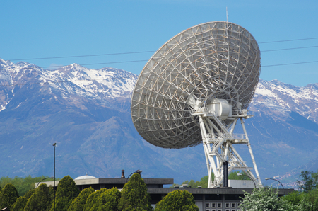 telephonic: Huge satellite dish in the Alps. Stock Photo