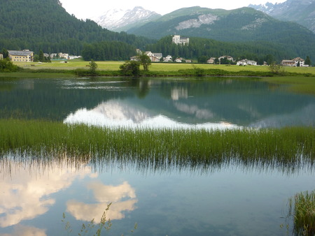 Alpine view of Lake Sils, next to village Sils Maria where philosopher Friedrich Nietzsche spent many summers. Upper Engadine valley, Grisons, Switzerland.
