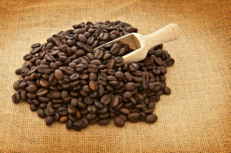 breackfast: Heap of coffee beans and shovel