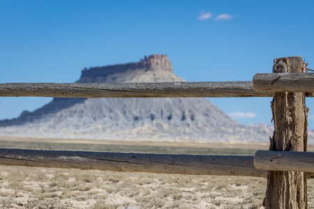 Factory butte behind a fence