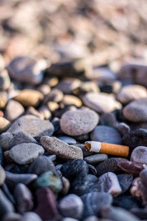 degradation: cigarette butt left on the beach