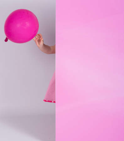foot marks: little girl sticking out from pink panel