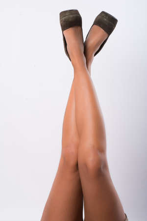 ankles sexy: tanned legs of young woman